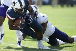 UConn running back Arkeel Newsome (22) falls into the endzone for a touchdown against East Carolina on Sunday.