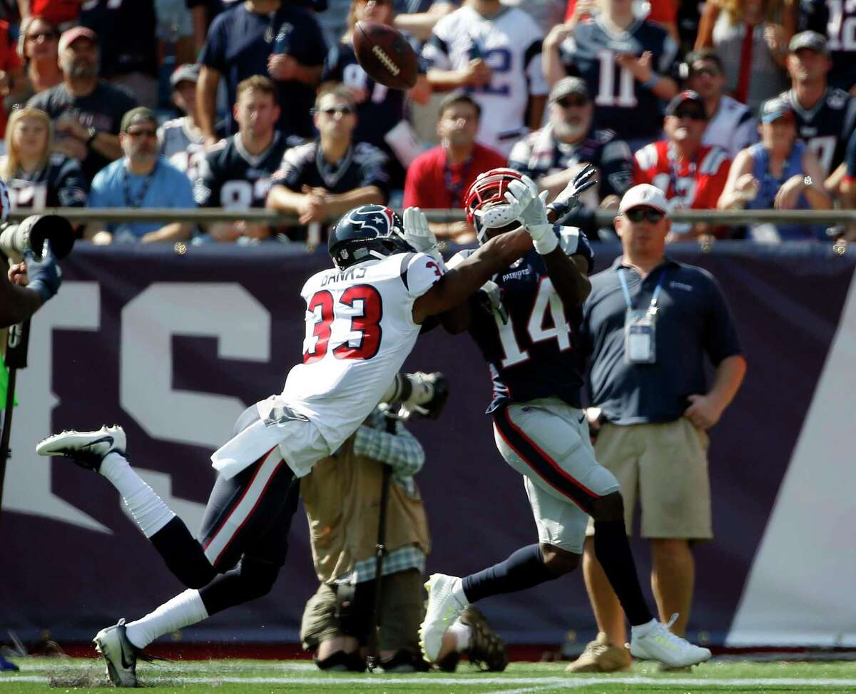 New England Patriots wide receiver Brandin Cooks (14) catches a pass as Houston Texans cornerback Johnthan Banks (33) defends during the first half of an NFL football game, Sunday, Sept. 24, 2017, in Foxborough, Mass. (AP Photo/Michael Dwyer)