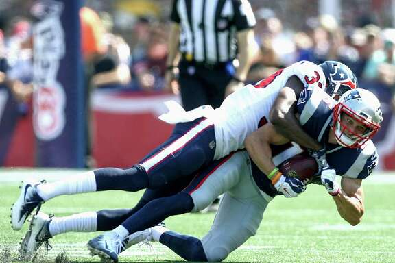 FOXBORO, MA - SEPTEMBER 24: Chris Hogan #15 of the New England Patriots is tackled after a catch by Johnthan Banks #33 of the Houston Texans during the first quarter of a game at Gillette Stadium on September 24, 2017 in Foxboro, Massachusetts.