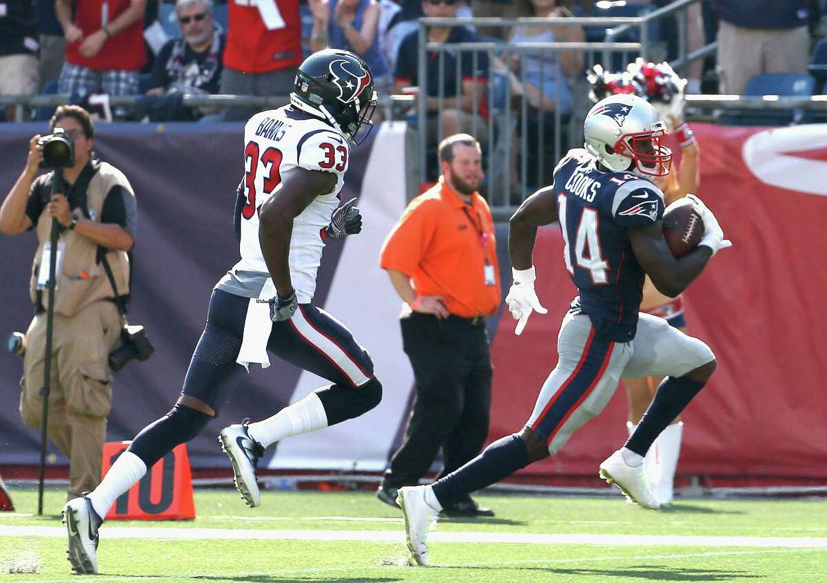 FOXBORO, MA - SEPTEMBER 24: Brandin Cooks #14 of the New England Patriots is pursued by Johnthan Banks #33 of the Houston Texans as he scores a touchdown during the third quarter of a game at Gillette Stadium on September 24, 2017 in Foxboro, Massachusetts.