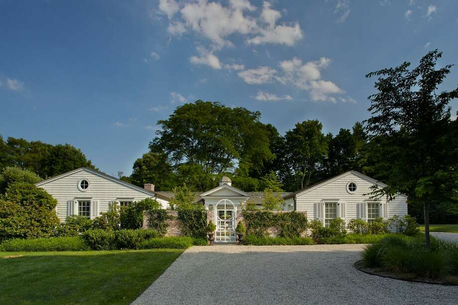 An unassuming bungalow at 440 Wahackme Road was transformed into an elegant ranch on a 1.77-acre property with a tennis court, bocce court and swimming pool.