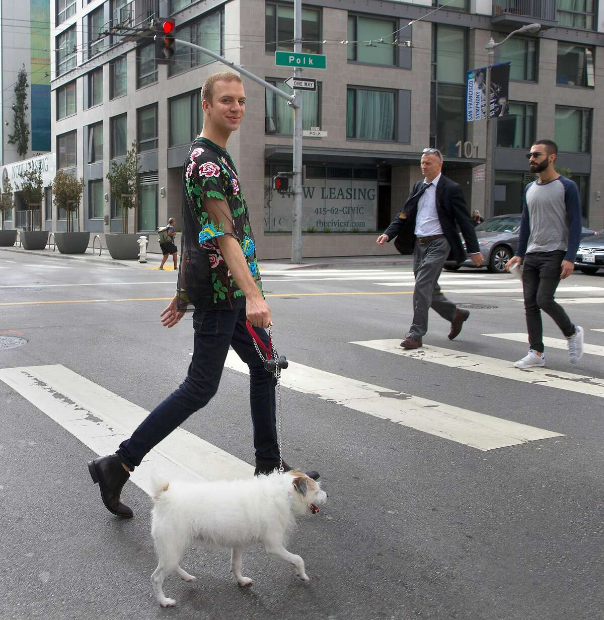 Mark Snyder walks their dog Willy in the Civic Center on Wednesday, September 20, 2017, in San Francisco. Instead of just having male or female designations, Snyder has strong hopes that legislation will pass in California creating a gender-neutral �X� identifier on ID cards.