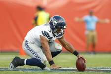 NASHVILLE, TN - SEPTEMBER 24:  Quarterback Russell Wilson #3 of the Seattle Seahawks recovers his own fumble against the Tennessee Titans at Nissan Stadium on September 24, 2017 in Nashville, Tennessee. (Photo by Wesley Hitt/Getty Images)