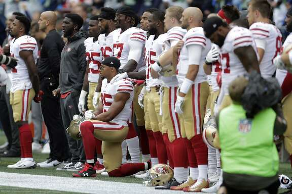 San Francisco 49ers strong safety Eric Reid kneels during the singing of the national anthem before an NFL football game against the Seattle Seahawks, Sunday, Sept. 17, 2017, in Seattle. (AP Photo/John Froschauer)