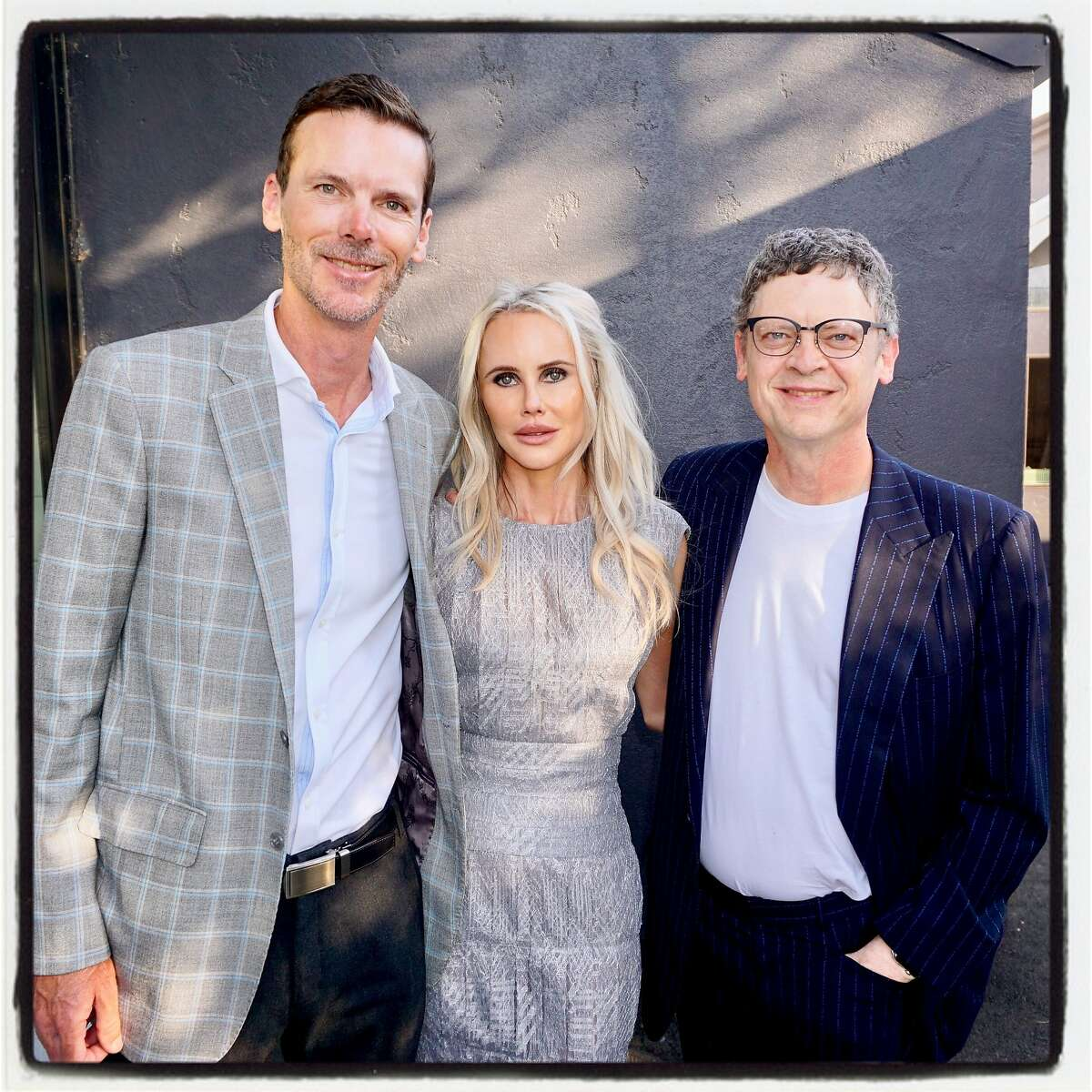Billy Getty (left) with his wife, Vanessa, and brother Peter Getty at Odette Winery for their Arts+Earth Initiative fundraiser. Sept. 16, 2017.