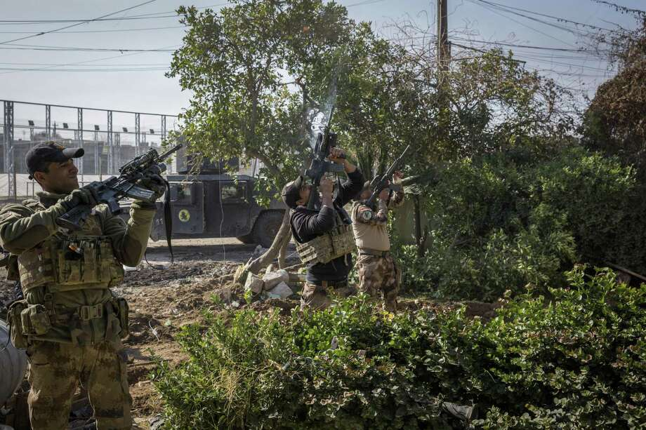 In January, Iraqi Special Operations soldiers try to shoot down an Islamic State drone armed with explosives in the Al Thaqafa neighborhood of eastern Mosul. Photo: Ivor Prickett /New York Times / NYTNS
