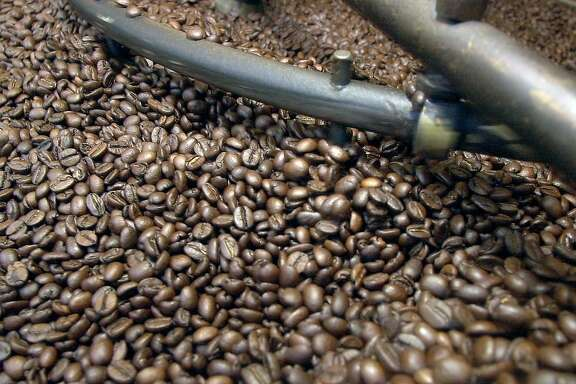 wifi080_db.jpg Fresh roasted coffee beans  as Anthony Azzollini's  roasts coffee beans at Caffe Roma on Columbus Ave. in North Beach while customers go to his cafe to use free Wi-Fi internet access.  8/20/03 in San Francisco. DARRYL BUSH / The Chronicle