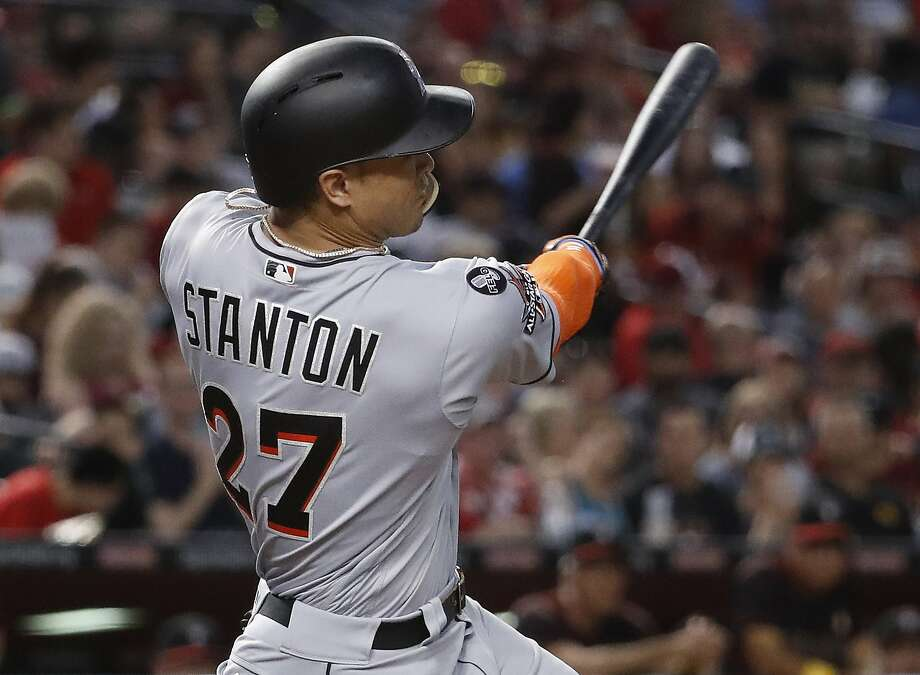 Miami Marlins' Giancarlo Stanton connects for a solo home run against the Arizona Diamondbacks during the fourth inning of a baseball game, Saturday, Sept. 23, 2017, in Phoenix. (AP Photo/Matt York) Photo: Matt York, Associated Press