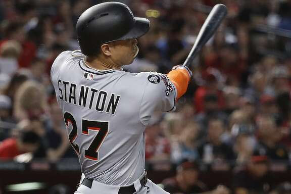 Miami Marlins' Giancarlo Stanton connects for a solo home run against the Arizona Diamondbacks during the fourth inning of a baseball game, Saturday, Sept. 23, 2017, in Phoenix. (AP Photo/Matt York)