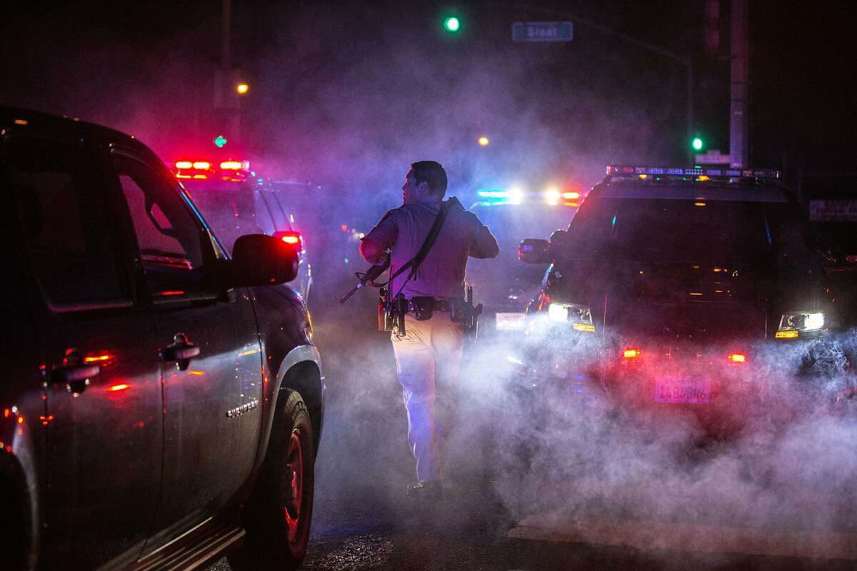 California Highway Patrol officials head to their vehicle to search for the suspect near 19th Avenue and Sloat Boulevard on Friday, Oct. 14, 2016 in San Francisco, Calif.