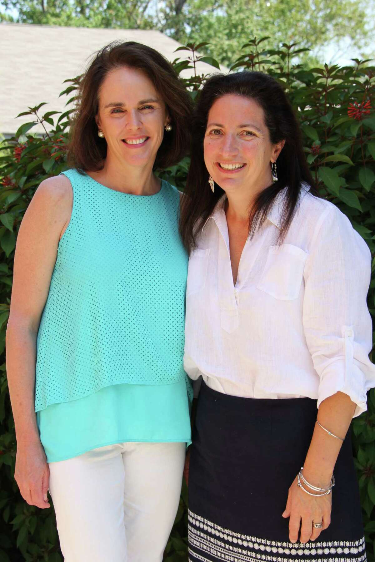 Susan DeMarco, left, and Christie Swanbeck are co-chairs of the Signatures Executive Committee that is seeking Visiting Author applications for the 2017 Signatures Author Series Dec. 8 featuring bestselling suspense novelist Paula Hawkins.
