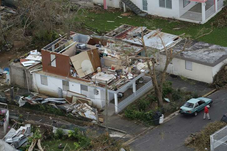 A damaged home is seen as people deal with the aftermath of Hurricane Maria in Levittown, Puerto Rico. Maria inflicted widespread damage across Puerto Rico, with virtually the whole island left without power or cell service.  (Photo by Joe Raedle/Getty Images)