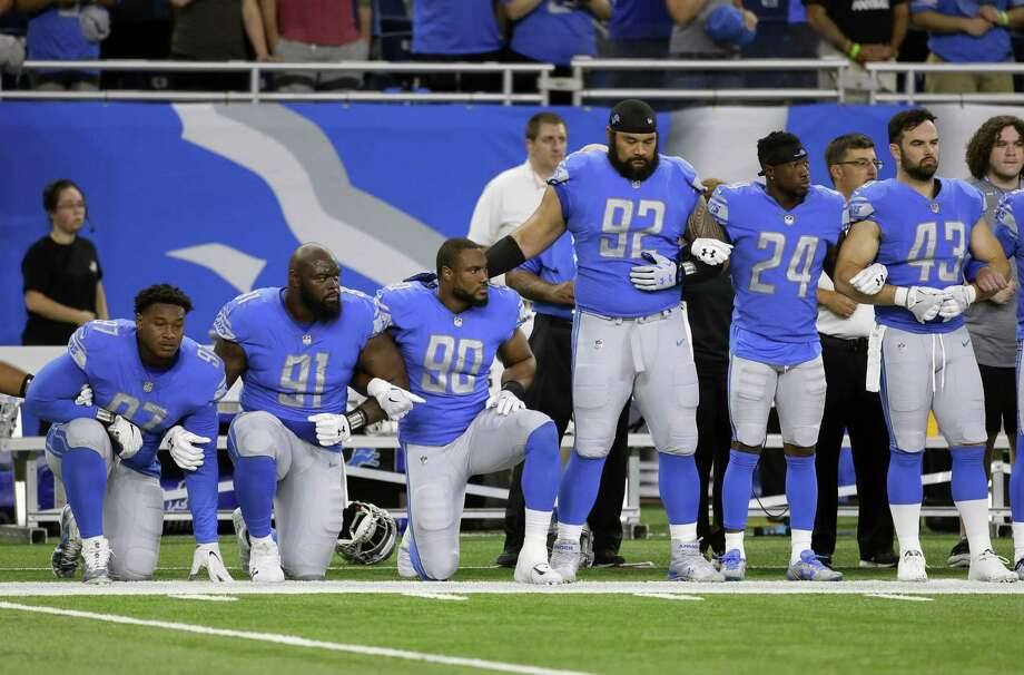 Detroit Lions defensive end Armonty Bryant (97), defensive tackle A'Shawn Robinson (91) and defensive end Cornelius Washington (90) take a knee during the national anthem before an NFL football game against the Atlanta Falcons, Sunday, Sept. 24, 2017, in Detroit. NFL sponsors, including San Antonio-based USAA, are walking a fine line with their patriotic customers as President Donald Trump called on supporters to boycott the NFL. Photo: Duane Burleson /Associated Press / FR38952 AP