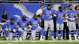 Detroit Lions defensive end Armonty Bryant (97), defensive tackle A'Shawn Robinson (91) and defensive end Cornelius Washington (90) take a knee during the national anthem before an NFL football game against the Atlanta Falcons, Sunday, Sept. 24, 2017, in Detroit. NFL sponsors, including San Antonio-based USAA, are walking a fine line with their patriotic customers as President Donald Trump called on supporters to boycott the NFL.