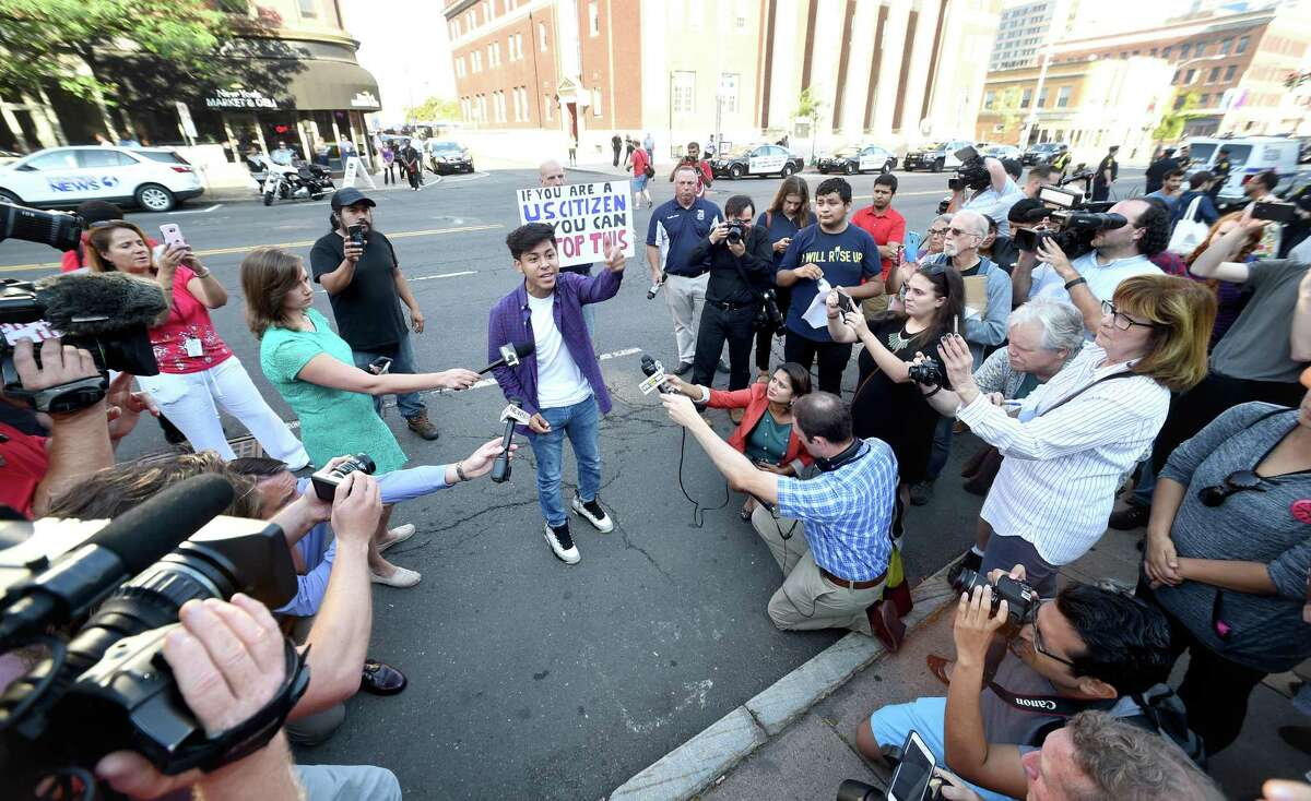Erick Ramos, 17, of Meriden speaks to supporters and members of the media concerning his parents imminent deportation in front of the Abraham A. Ribicoff Federal Building and Courthouse in Hartford on September 25, 2017 after his brother, Jason, and other supporters were arrested blocking the entrance to the building. Arnold Gold / Hearst Connecticut Media