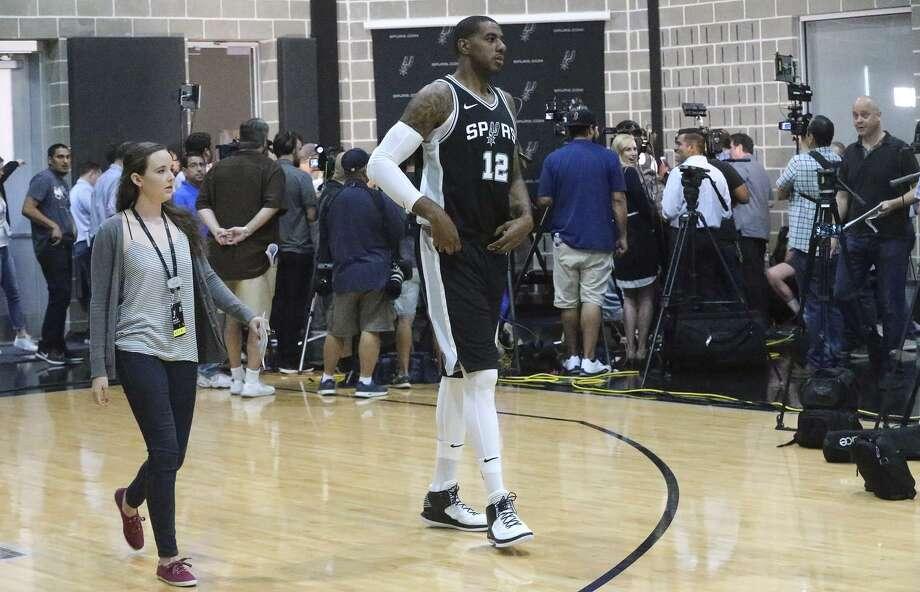 Forward LaMarcus Aldridge walks into Spurs media day on Sept. 25, 2017, at the team's practice facility in San Antonio. Photo: John Davenport /San Antonio Express-News / ©San Antonio Express-News/John Davenport