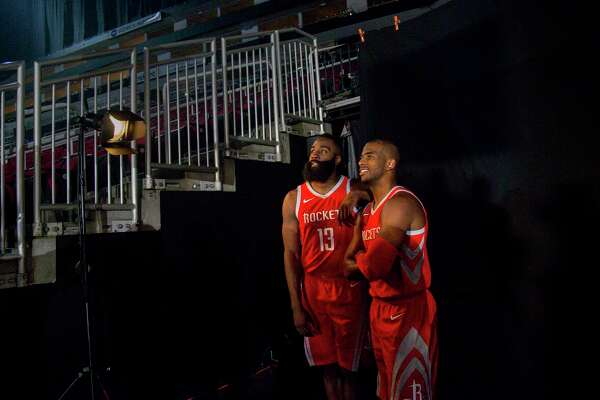 Rockets guards James Harden (13) and Chris Paul did plenty of smiling for the camera during media day Monday.