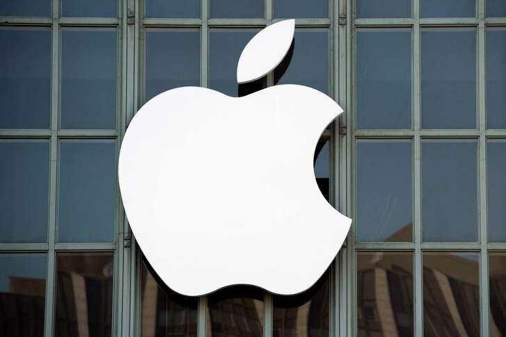 """(FILES) This file photo taken on September 7, 2016 shows the Apple logo on the outside of Bill Graham Civic Auditorium in San Francisco, California. Apple sent out invitations on August 31, 2017 to a first-ever media event in the Steve Jobs Theater at its new """"spaceship"""" campus in Silicon Valley. The keenly anticipated event set for September 12 is expected to star iPhone models marking the tenth anniversary of the culture-changing smartphones. In trademark style, Apple revealed little in the invitation that provided the date, time, location and a message that read """"Let's meet at our place.""""  / AFP PHOTO / Josh EdelsonJOSH EDELSON/AFP/Getty Images"""
