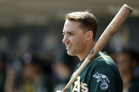 Oakland Athletics first baseman Matt Olson looks out from the dugout during the third inning of a baseball game against the Detroit Tigers, Wednesday, Sept. 20, 2017, in Detroit. (AP Photo/Carlos Osorio)