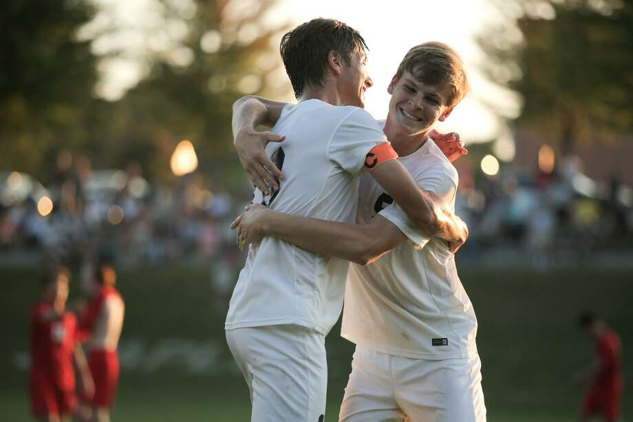 Will Birch celebrates with Matt Engler after Staples' 1-0 victory over Greenwich at Staples High School in Westport, Conn. on Monday, September 25, 2017. Photo: Chris Palermo / For Hearst Connecticut Media / Norwalk Hour Freelance