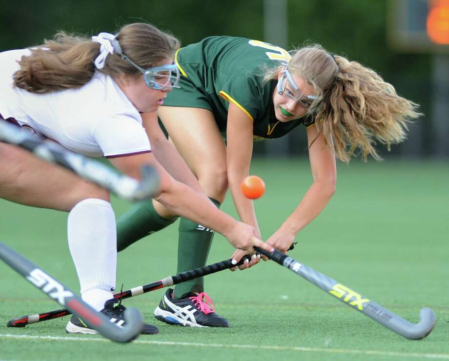 Greenwich Academy's Evelyn Barringer, right, shoots around a St. Luke's defender in Greenwich Academy's 5-0 win Monday at Greenwich Academy. The Gators have outscored their opponents 20-0 in four wins to open the season. Photo: Tyler Sizemore / Hearst Connecticut Media / Greenwich Time