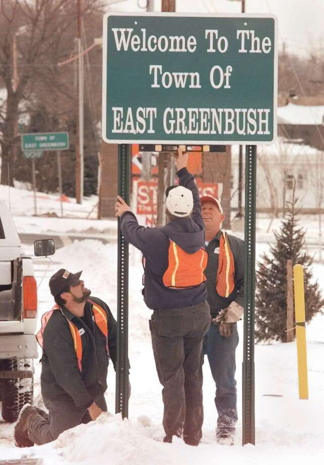 Click through the slideshow to see how Route 4 and the surrounding areas between North and East Greenbush have changed through the years.Times Union Staff Photo by Jonathan Fickies -- East Greenbush Department of Public Works employees, from left, George Cotugno, Paul Mason, and Warren Kretzschmar make sure a new town sign is level along Route 4 at The Shoppes at Greenbush Commons plaza Friday, March 12, 1999.  The old sign, posted on an old tax map boundary, is seen down the road in the backround at left. Photo: JONATHAN FICKIES, DG / ALBANY TIMES UNION