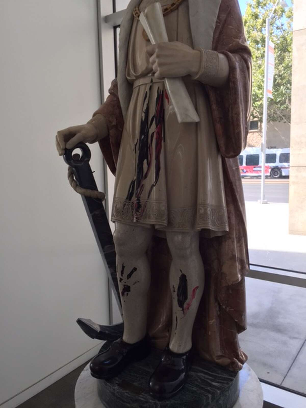 A woman was arrested and cited Friday for vandalizing a controversial statue of Christopher Columbus in San Jose City Hall.