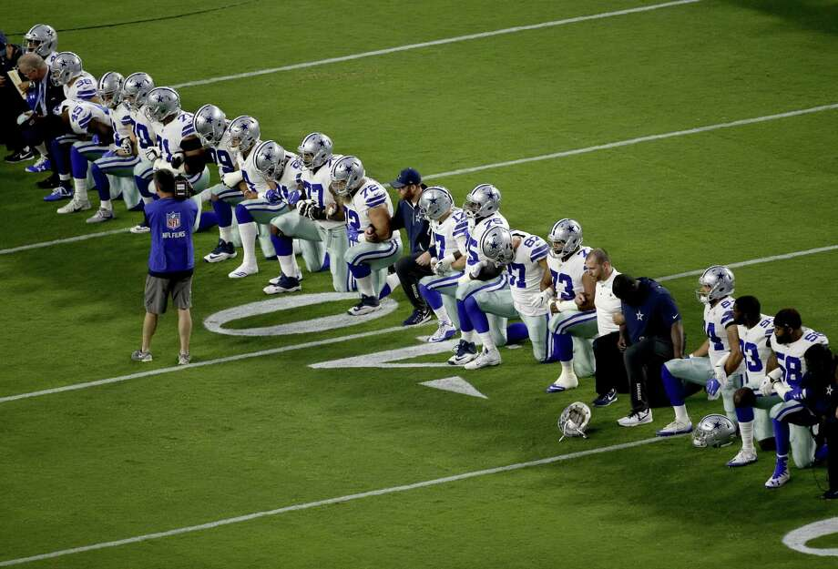The Dallas Cowboys take a knee prior to the national anthem on Monday night when they faced the Arizona Cardinals in Glendale, Arizona. The team later stood on the sideline for the anthem. Photo: Matt York /Associated Press / Copyright 2017 The Associated Press. All rights reserved.