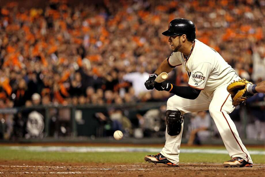 Gregor Blanco bunts for a single in Game 2 of the 2012 World Series against the Tigers at AT&T Park. Photo: Christian Petersen, Getty Images