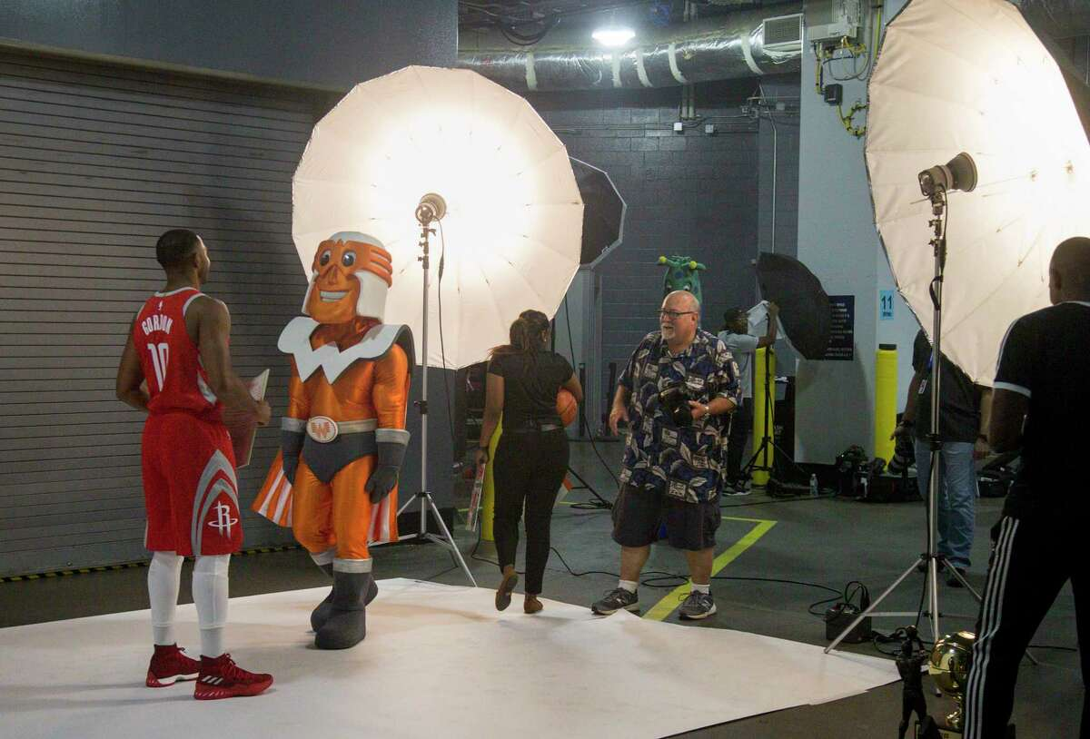 Rockets guard Eric Gordon works with the Whataburger mascot during media day.