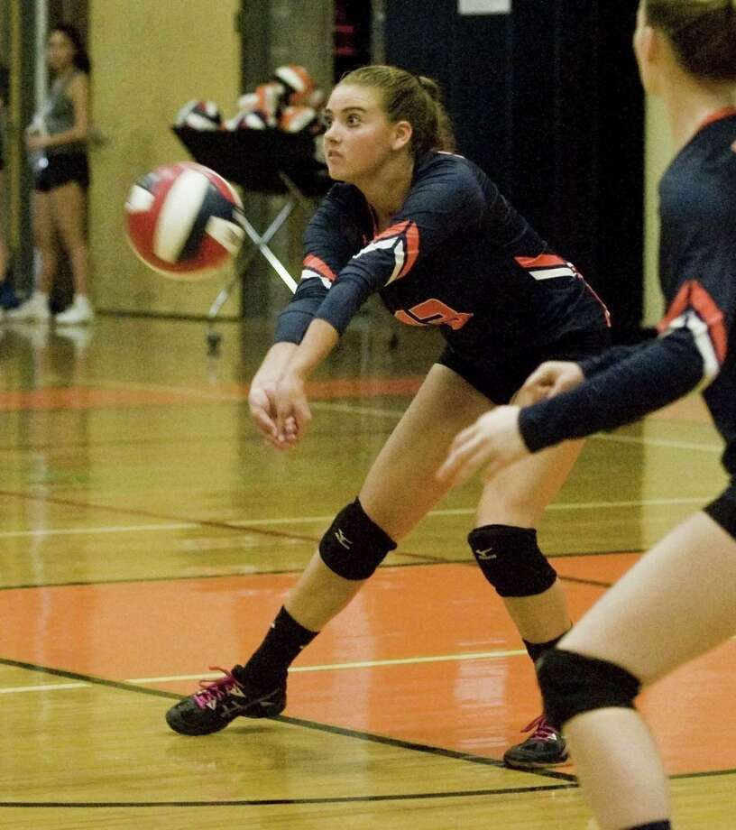 Danbury High School's Alex Cooke returns a serve in a game against Ridgefield High School, played at Ridgefield. Monday, Sept. 25, 2017 Photo: Scott Mullin / For Hearst Connecticut Media / The News-Times Freelance