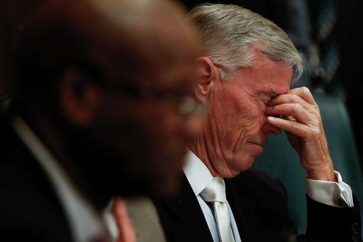 Houston City Council Member at Large Jack Christie D.C.reacts while listening to testimony at the first of three public hearings for Mayor Sylvester Turner's proposed tax hike to help cover the costs the city will incur because of Hurricane Harvey Monday, Sept. 25, 2017 in Houston.