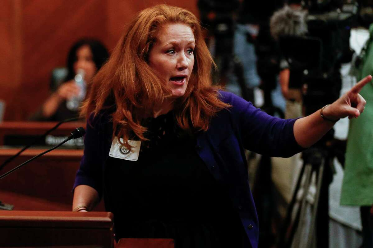 Mindy Smith gets animated as she testifies about her opposition to Mayor Sylvester Turner's proposed tax hike to help cover the costs the city will incur because of Hurricane Harvey at the first of three public hearings Monday, Sept. 25, 2017 in Houston.