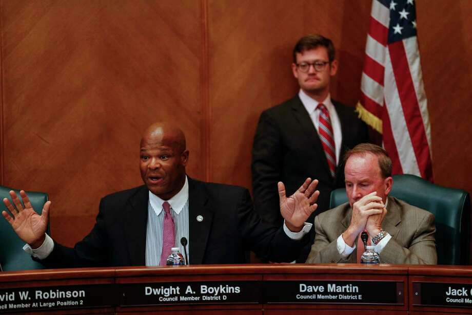 Houston City Council member District D Dwight Boykins, left, gets animated as he speaks with Texas State Senator Paul Bettencourt at the first of three public hearings for Mayor Sylvester Turner's proposed tax hike to help cover the costs the city will incur because of Hurricane Harvey Monday, Sept. 25, 2017 in Houston. Photo: Michael Ciaglo, Houston Chronicle / Michael Ciaglo