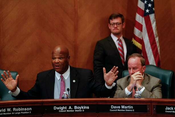 Houston City Council member District D Dwight Boykins, left, gets animated as he speaks with Texas State Senator Paul Bettencourt at the first of three public hearings for Mayor Sylvester Turner's proposed tax hike to help cover the costs the city will incur because of Hurricane Harvey Monday, Sept. 25, 2017 in Houston.