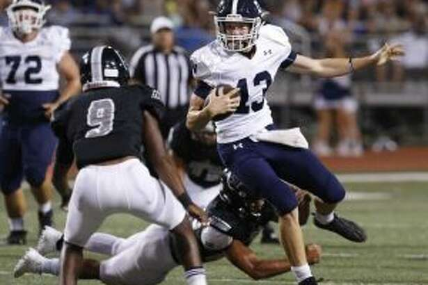 Smithson Valley quarterback Levi Williams (13) accounted for 235 yard and three touchdowns in Rangers' District 27-6A win over Steele. Photo by Kin Man Hui/Express-News