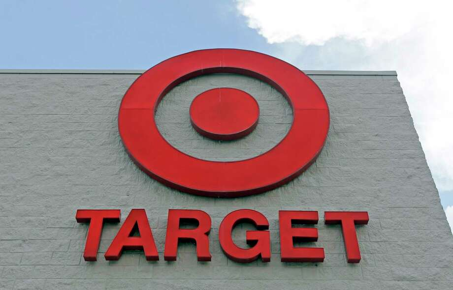 FILE - This Wednesday, June 29, 2016, file photo, shows a Target store in Hialeah, Fla. Target Corp. is raising its minimum hourly wage for its workers to $11 starting in October 2017 and then to $15 by the end of 2020 in a move it says will help it better recruit and retain staff and provide a better shopping experience for its customers. (AP Photo/Alan Diaz, File) Photo: Alan Diaz, STF / Copyright 2016 The Associated Press. All rights reserved. This material may not be published, broadcast, rewritten or redistribu