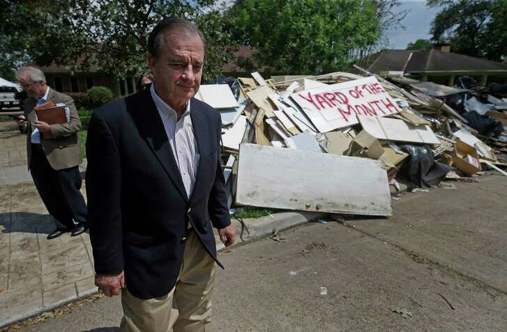 John Sharp tours a flooded neighborhood near Westbury High School last week in Houston. He routinely gives his cellphone number to officials.