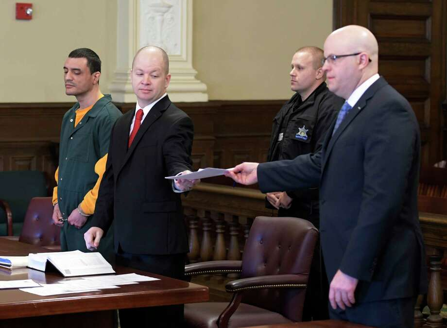 Johnny Oquendo, left appears in Rensselaer County Court with his attorney William Roberts for his arraignment for the alleged murder of his step daughter Noel Alkaramla Tuesday Dec. 6, 2016 Troy, N.Y. Representing the prosecution is Rensselaer County District Attorney Joel Abelove, right. (Skip Dickstein/Times Union) Photo: SKIP DICKSTEIN / 20039061A