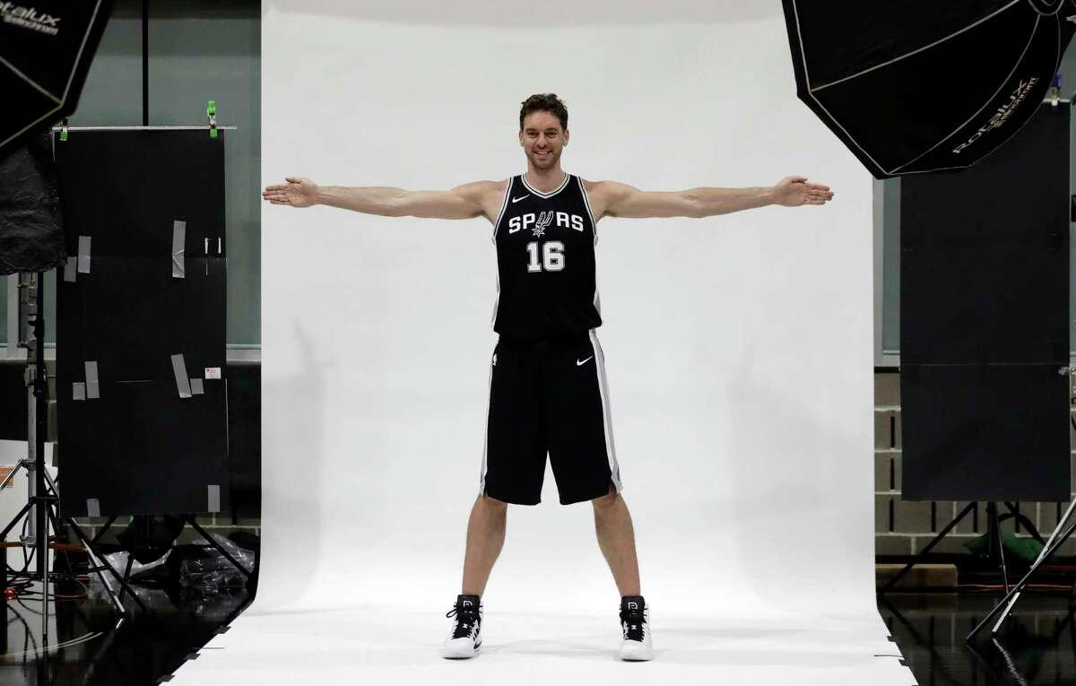 San Antonio Spurs center Pau Gasol (16) poses for photos during media day at the team's practice facility, Monday, Sept. 25, 2017, in San Antonio. (AP Photo/Eric Gay)