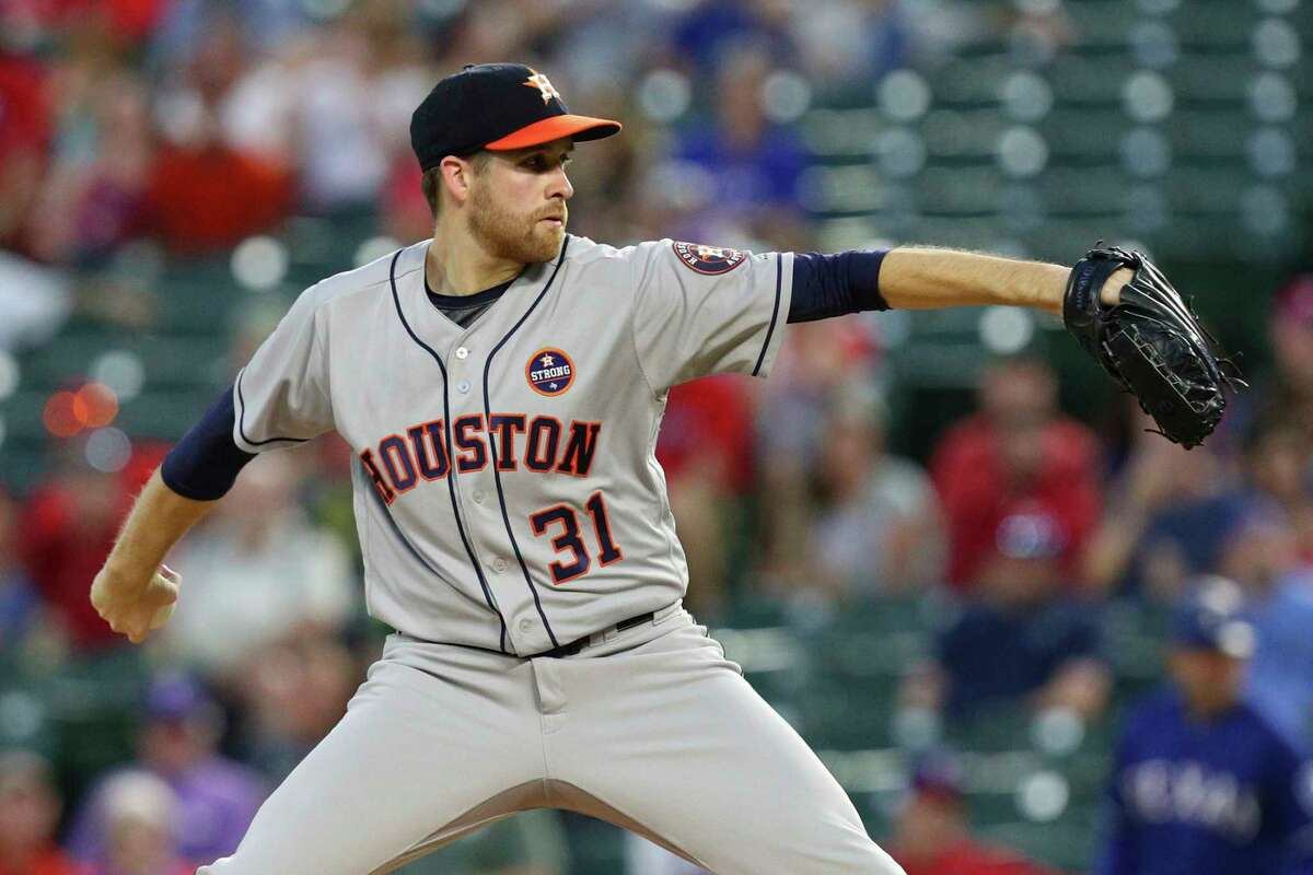 Houston Astros starting pitcher Collin McHugh (31) delivers a pitch against the Texas Rangers in the first inning of a baseball game Monday, Sept. 25, 2017, in Arlington, Texas.. (AP Photo/Richard W. Rodriguez)