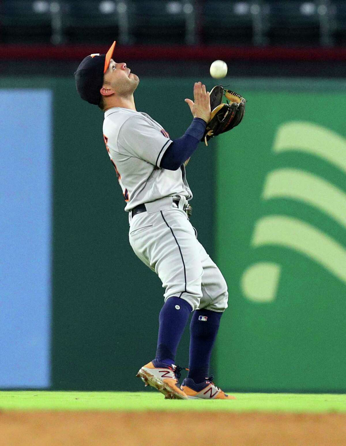 Houston Astros second baseman Jose Altuve catches a fly ball by Texas Rangers' Adrian Beltre in the first inning of a baseball game Monday, Sept. 25, 2017, in Arlington Texas. (AP Photo/Richard W. Rodriguez)