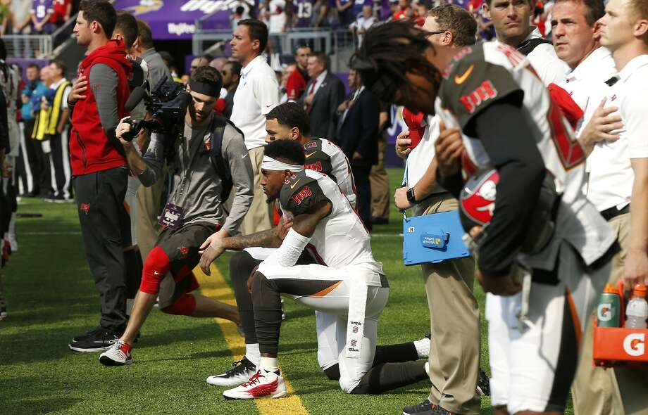 Tampa Bay Buccaneers wide receiver DeSean Jackson, center, takes a knee during the national anthem before an NFL football game against the Minnesota Vikings, Sunday, Sept. 24, 2017, in Minneapolis. (AP Photo/Jim Mone) Photo: Jim Mone, Associated Press
