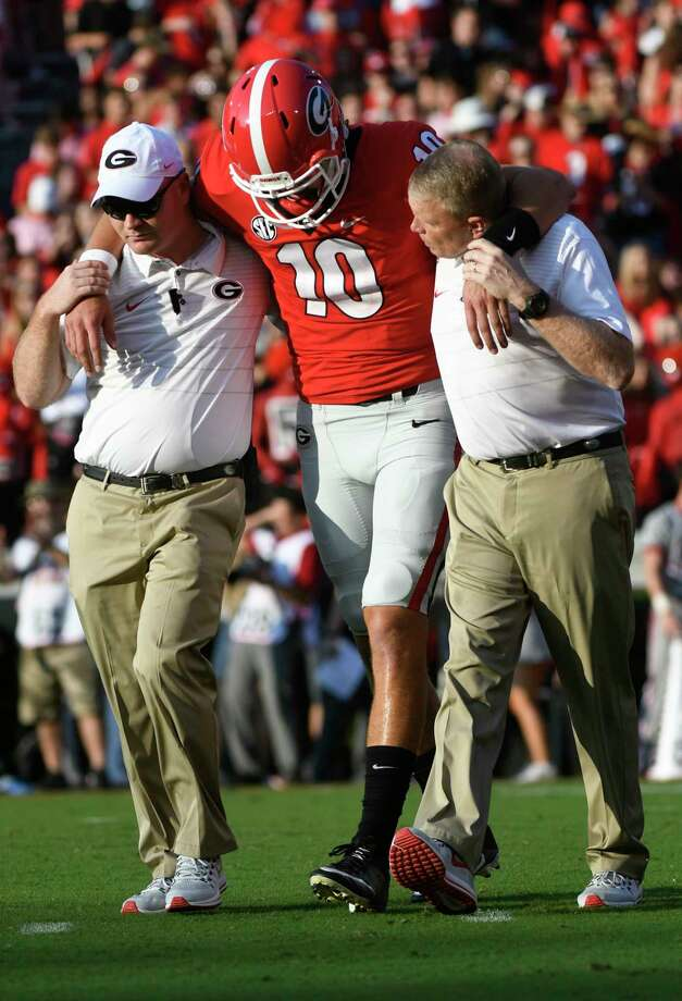 Georgia quarterback Jacob Eason (10) is helped off the field after in injury during the first quarter of an NCAA college football game against Appalachian State, Saturday, Sept. 2, 2017, in Athens, Ga. (AP Photo/John Amis) ORG XMIT: GAJA103 Photo: John Amis / FR69715 AP