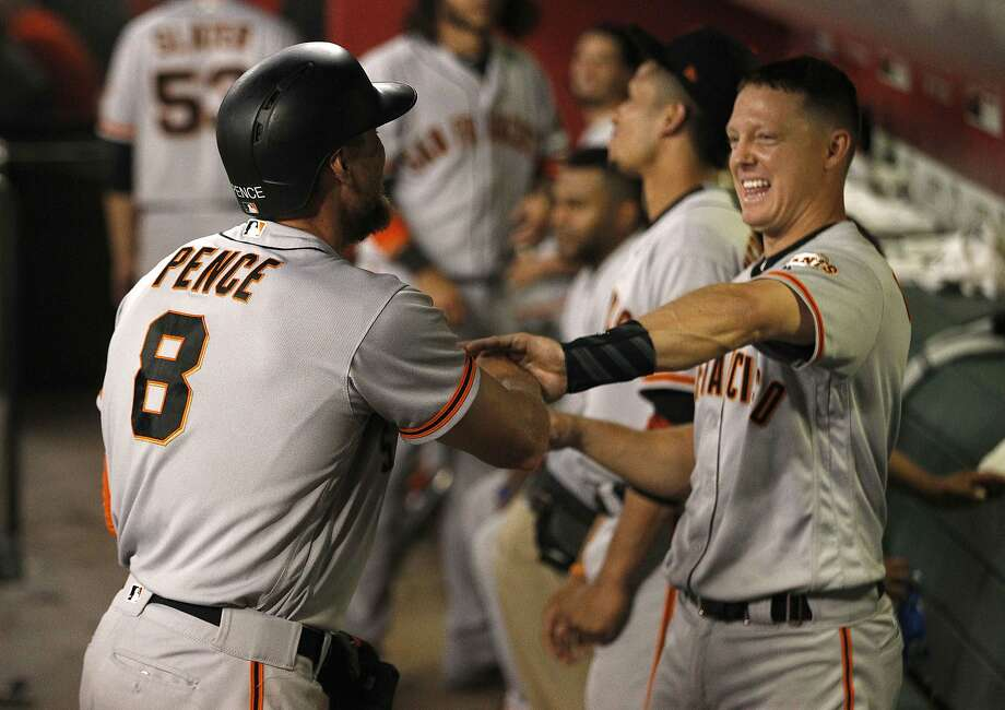 Nick Hundley goofs with Giants teammate Hunter Pence after each homered in the fourth inning Monday night. Photo: Darryl Webb, Associated Press