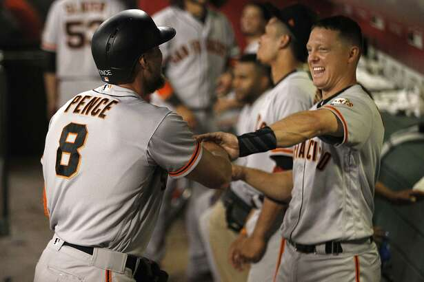 San Francisco Giants' Hunter Pence and Nick Hundley have a little fun with each other after the pair hit home runs against the Arizona Diamondbacks in the fourth inning inning of a baseball game, Monday, Sept. 25, 2017 in Phoenix. Hundley had a three run home run while Pence had a solo shot. (AP Photo/Darryl Webb)