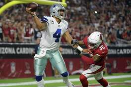 GLENDALE, AZ - SEPTEMBER 25:  Quarterback Dak Prescott #4 of the Dallas Cowboys throws a pass under pressure from safety Budda Baker #36 of the Arizona Cardinals during the second half of the NFL game at the University of Phoenix Stadium on September 25, 2017 in Glendale, Arizona.  (Photo by Jennifer Stewart/Getty Images) ORG XMIT: 700070643