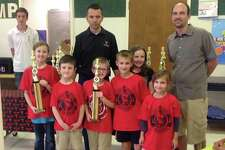 In its first tournament of the season, the Plainview Homeschool Chess Club won the First Place Rated K-5 trophy at the Check with Tech Tournament. Shown are club members Eowyn Thornhill (left), Daniel Thornhill, Montana Moore, Dylan Stone, Anara Thornhill and Jasmine Stone with Texas Tech Chess Team member Richard Davisson, Grandmaster Alexander Onischuk (Tech Chess coach), and PHCC Coach Robert Moore.
