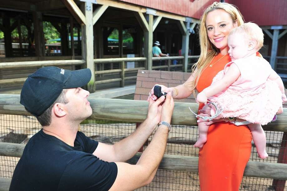 "Erica Rose says 'yes!"" to Charles Sanders during her daughter's first birthday party at the Houston Zoo. Photo: Herb Hochman"