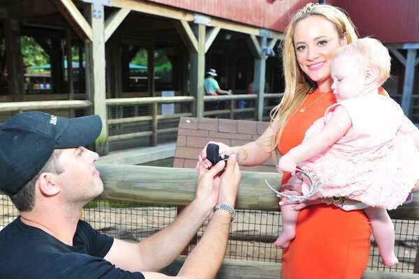"Erica Rose says 'yes!"" to Charles Sanders during her daughter's first birthday party at the Houston Zoo."